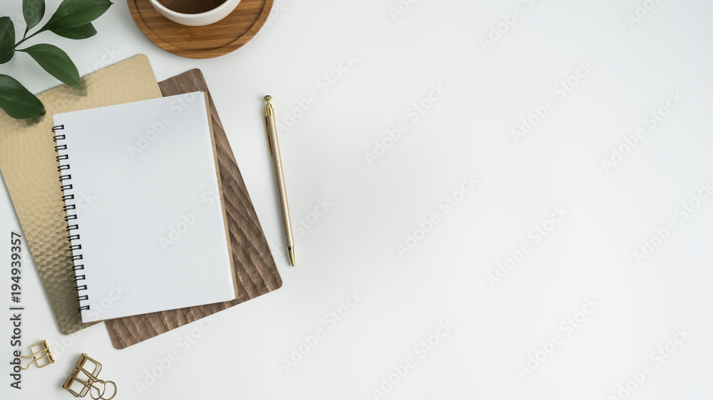Fototapeta Styled stock photography white office desk table with blank notebook, computer, supplies and coffee cup. Top view with copy space. Flat lay.