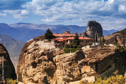 Poster Chocoladebruin Landscape of monasteries of Meteora in Greece in Thessaly at the early morning. Cliffs of Meteora opposite a morning cloudy sky background