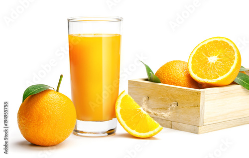 Glass of fresh orange juice on wooden table, Fresh fruits Orange juice in glass with group of orange on white background, Selective focus on glass, isolate white background