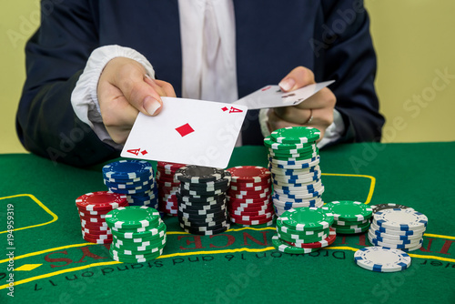 Foto  Woman hands give one ace, close up