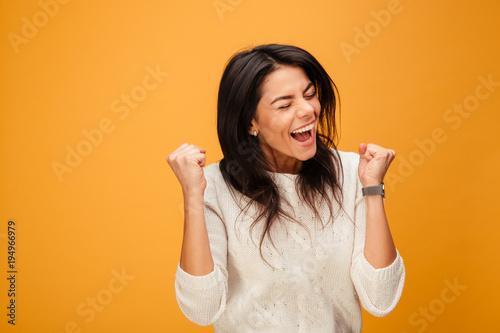 Obraz na płótnie Portrait of an excited young woman celebrating success