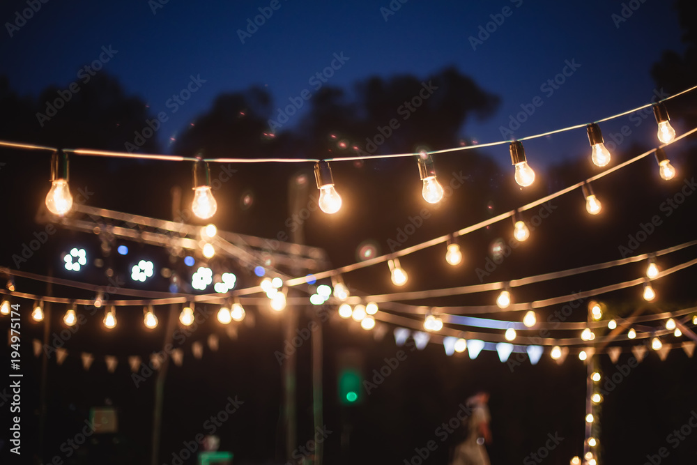 Fototapety, obrazy: A garland of light bulbs in the decoration of the night ceremony