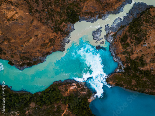 Fototapeta Aerial view of the confluence of the river of Baker (blue) and the river of Neff, Chile obraz
