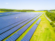canvas print picture - Aerial view of solar power plant. Solar farm system from above. Large photovoltaic power station next to the highway. Source of ecological renewable energy.