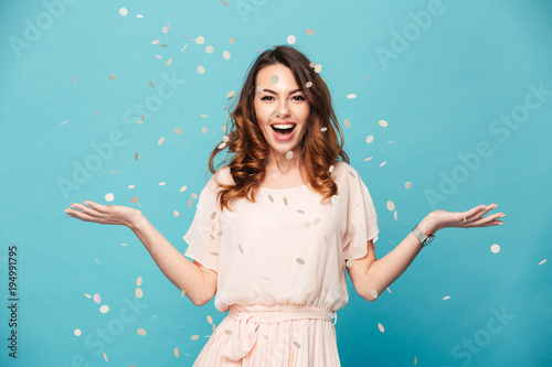Portrait of a cheerful beautiful girl wearing dress Poster