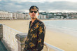 Adult man standing on beach