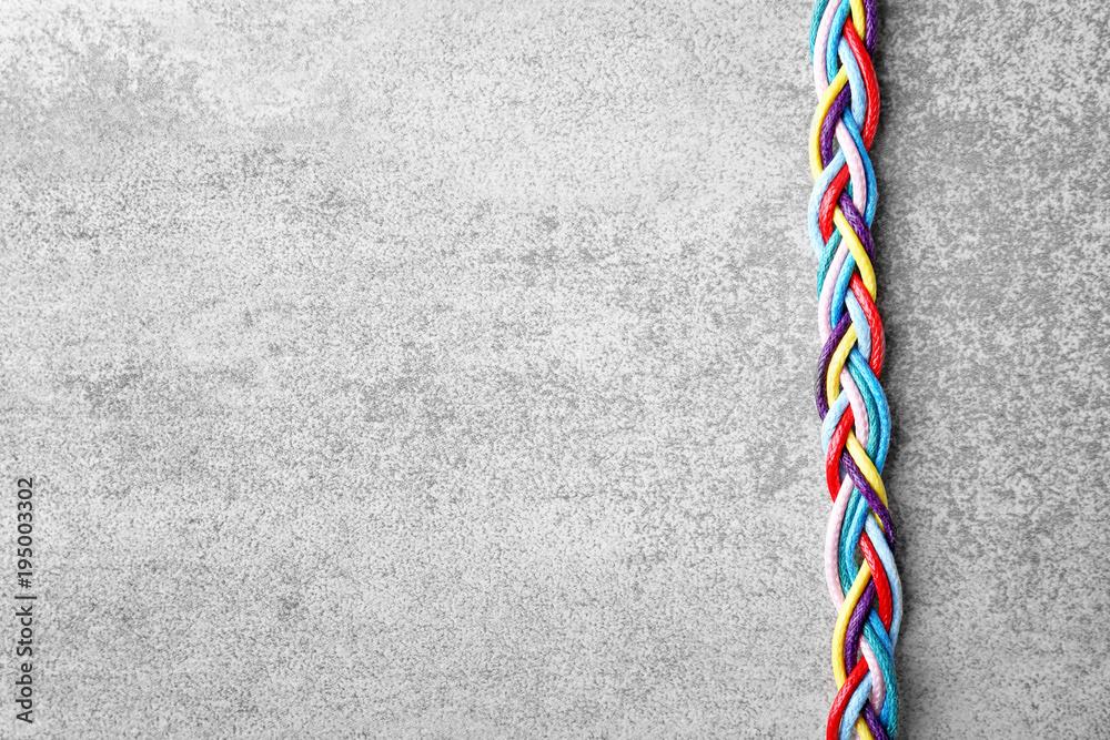 Fototapeta Braided strings on light background. Unity concept