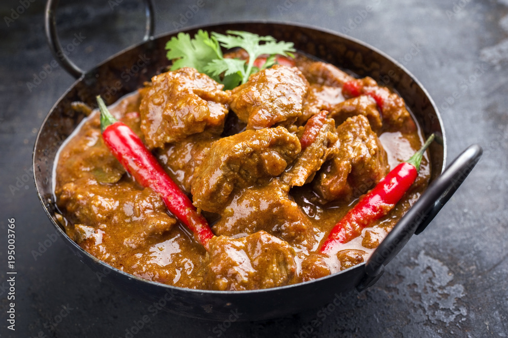 Fototapety, obrazy: Traditional Indian curry lamb masala as close-up in a Korai