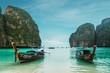 Two boats in green ocean water
