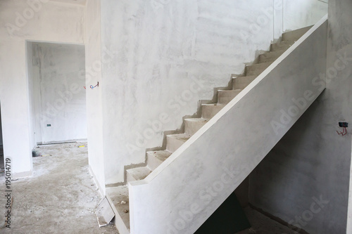 New House Construction With Concrete Staircase At Building Site
