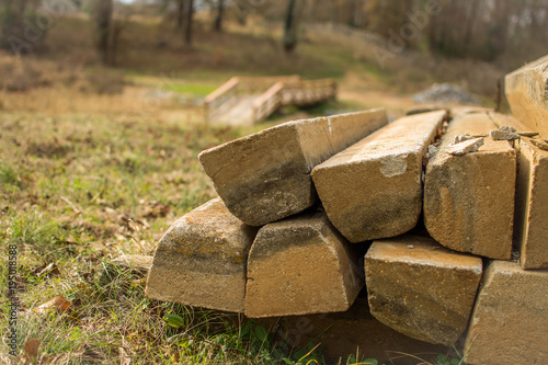 Fotografie, Obraz  Stack of bridge posts