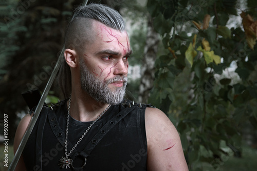 Cosplay, dressed like a hero Geralt of Rivia from the game the Witcher, a fantas Canvas Print