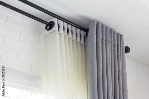 Photo The white curtains with ring-top rail, Curtain interior decoration in living roo