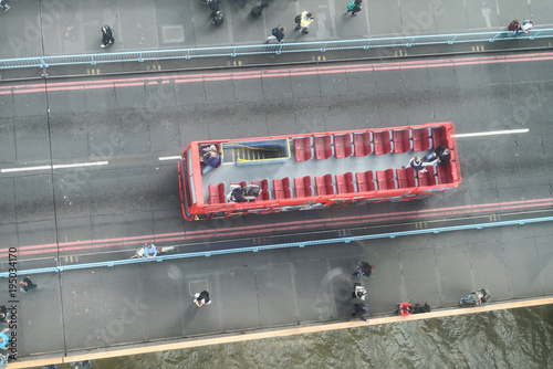 Poster Londres bus rouge LONDON - SEPTEMBER 25, 2016: Tourist bus overhead aerial view. The city attracts 30 million tourists annually