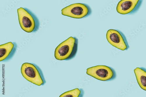 Avocado on the blue background. Top view
