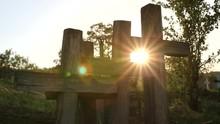 Shiny Sun Lighting In A Graveyard Between Christian Cross