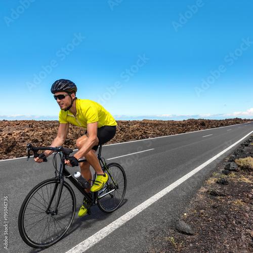 Road biking cyclist man training on bike professional