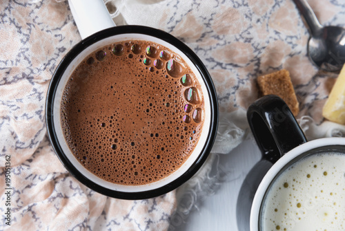 Mug of hot chocolate or cocoa and white chocolate. Close up.