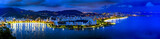 Panoramic image of Rio de Janeiro seen from above at night with its lights, hills, streets, Gaunabara bay and Santos Dumont airport