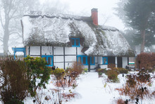 Winter Snow Covered Thatched C...