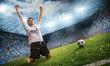 Leinwanddruck Bild Jubelnder Fußballspieler