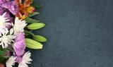 Fototapeta Kwiaty - Beautiful Colorful Spring Flowers Bouquet Over Blackboard Texture Dark Background With Copy Space, Horizontal