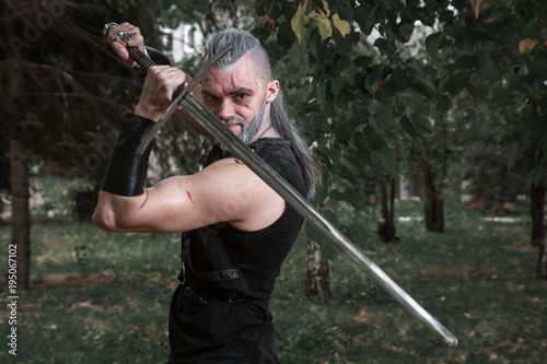 Photo  сosplay, dressed like a hero Geralt of Rivia from the game the Witcher, a fantas