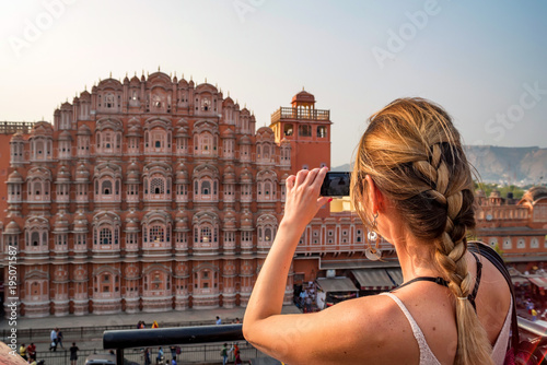 Photo  Young woman takes picture of Hawa Mahal in India