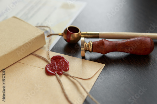 Fountain pen and old notarial wax seal on document, closeup Canvas Print