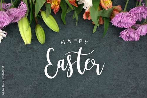 Poster Countryside Happy Easter Text With Beautiful Colorful Flowers Bouquet Border Shot From Directly Above Over Black Dark Texture Background, Horizontal