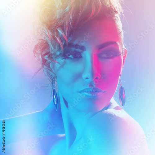 Garden Poster Beauty Beautiful stylish woman with professional hair and makeup. Creative dramatic pink and blue lights.