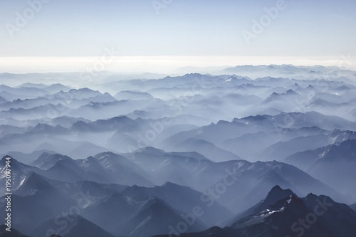 Poster Scandinavie Foggy mountains from the sky