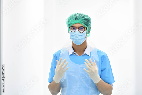 Fotografie, Obraz  Asian male obstetrician with mask ready for operation in hospital