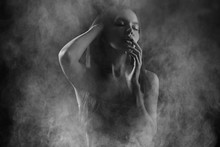 Portrait Of A Sexy Girl With Smoke