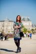 girl in beautiful dress walking near Luxemburg garden