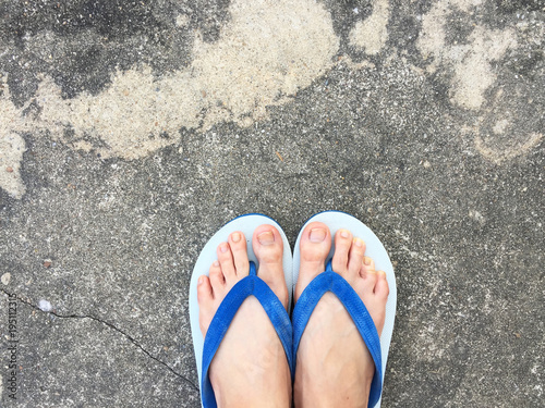 Close Up Blue Flip Flop Isolated On Cement FloorTop View Beautiful Woman Wearing