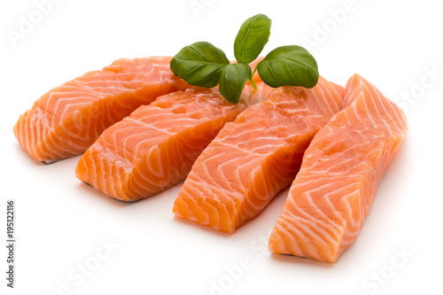 Fresh salmon fillet with basil on the white background. Canvas-taulu