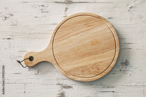 Wooden chopping board on wooden background