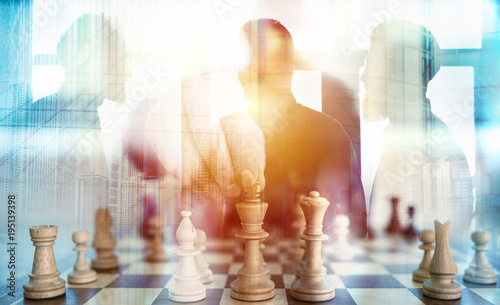 Fotomural  Business tactic with chess game and businessmen that work together in office