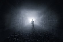Man In A Dark Concrete Tunnel ...