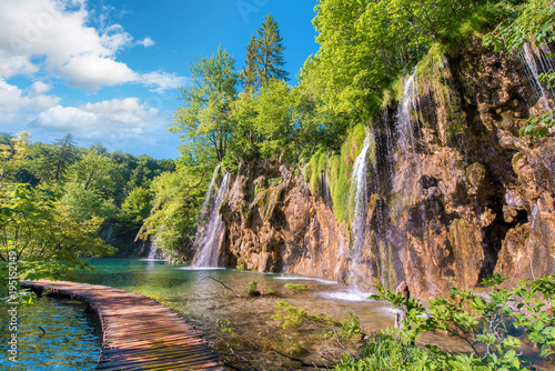 obraz dibond Incredibly beautiful fabulous magical landscape with a bridge near the waterfall in Plitvice, Croatia (harmony meditation, antistress - concept)