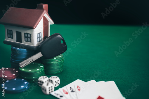 фотография  Poker game with high stakes on table