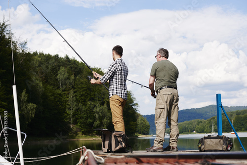 Tuinposter Ontspanning Rear view of men fishing