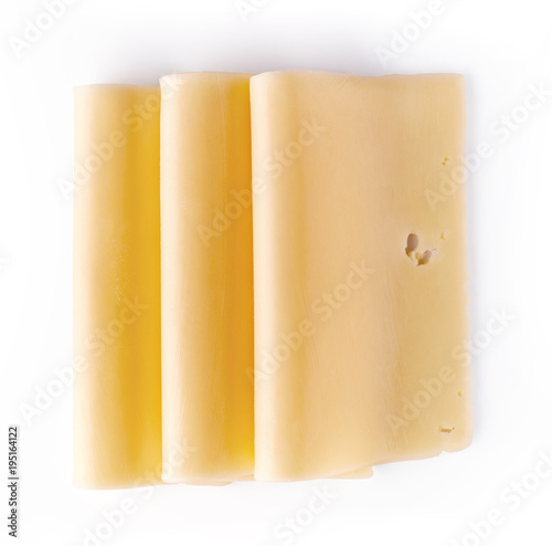 Cheese slices isolated on white, from above