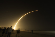 Space X Launch Of Falcon 9 Car...