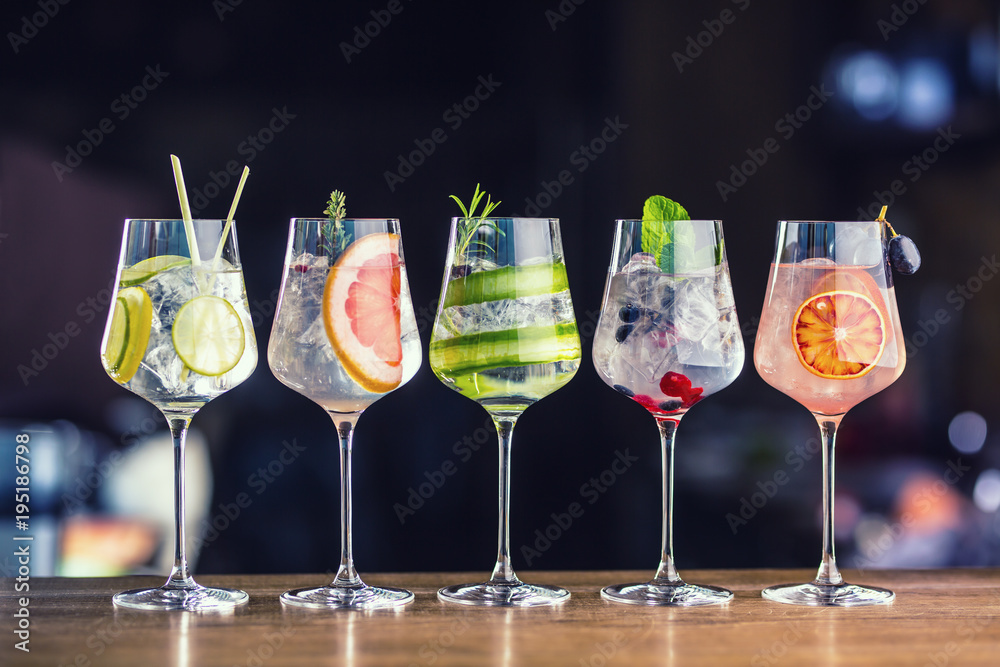 Fototapety, obrazy: Five colorful gin tonic cocktails in wine glasses on bar counter in pup or restaurant