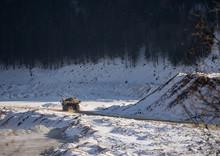 Haul Truck Carrying Ore In An Open Pit Mine