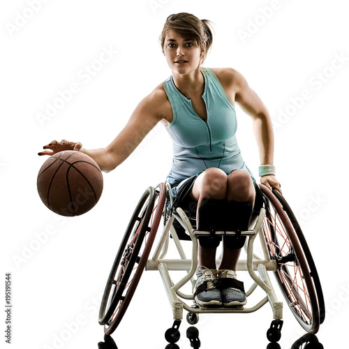 one caucasian young handicapped basket ball player woman in wheelchair sport  tudio in silhouette isolated on white background