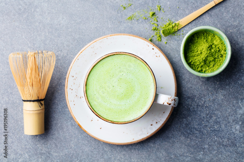 Stickers pour porte The Matcha green tea latte in a cup with bamboo whisk. Top view.