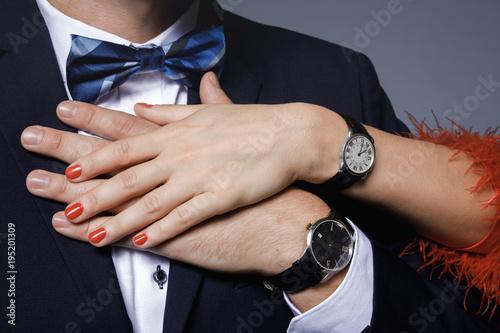 Well dressed stylish couple wearing wristwatches